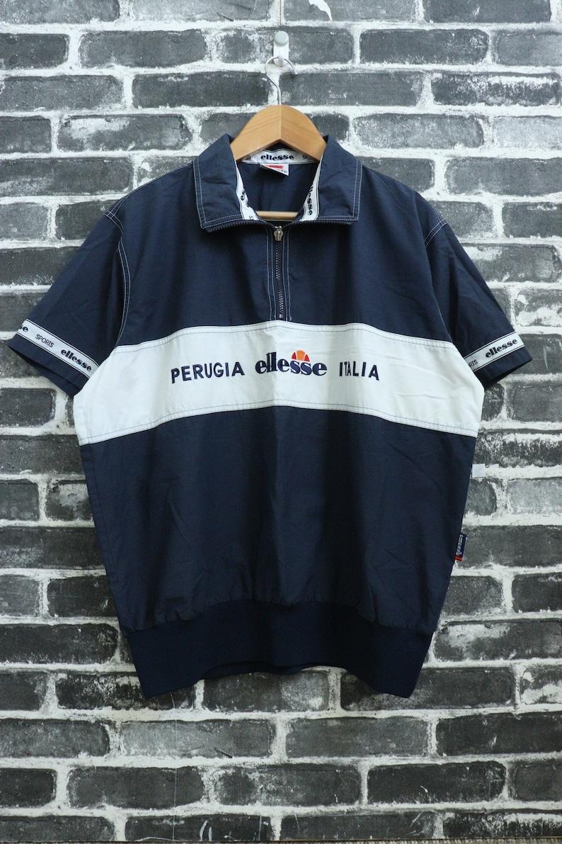 e871885892b4e ELLESSE Swoosh Vintage short sleeve Jacket Navy Embroidered Training Warm  Up Wear/Stadium track training/Street wear/Active wear