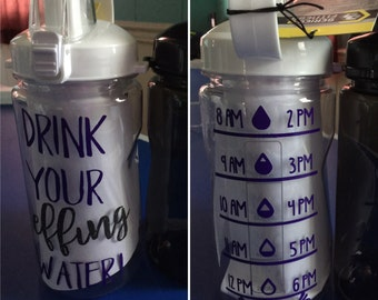 Drink your effing water. 34oz water bottle with flip handle. avail in black, red, green or white