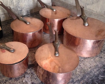 Five Dehillerin thick copper saucepans with stick lids, vintage, tin lined