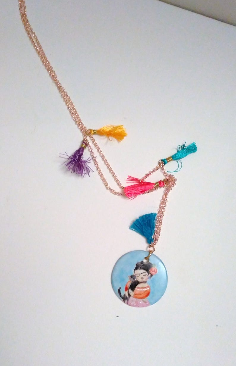 with coloured tassets and hand-painted porcelain medallion, Long necklace in gilded brass