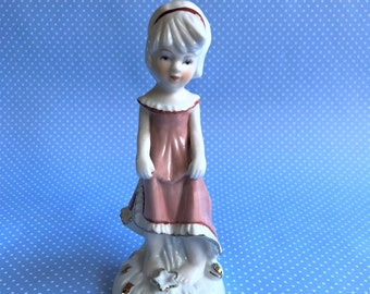 Vintage Porcelain Figurine of little girl in Pink Dress Lenea B