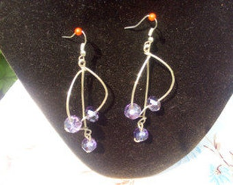 Earrings in silver wire and crystals