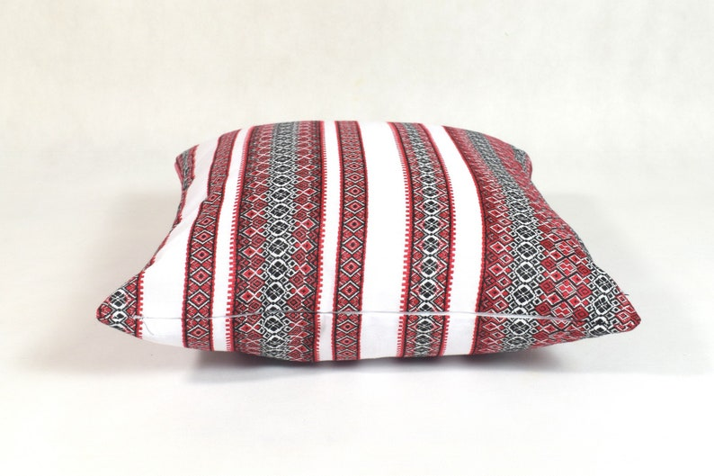 black and white and red decorative pillows White linen and cotton pillow with red and black folk patterns ethnic pattern pillow