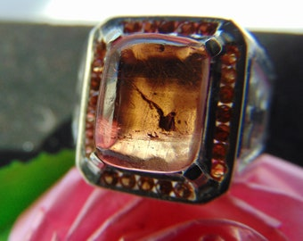 Ring 'Polychrome overflow'. The price: 79 dollars. Tourmaline and orange sapphire