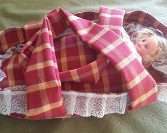 Quilted doll bassinet.