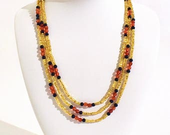 Layerable Golden, Red and Black Beaded Necklace- crafted by Nepalese human trafficking victims