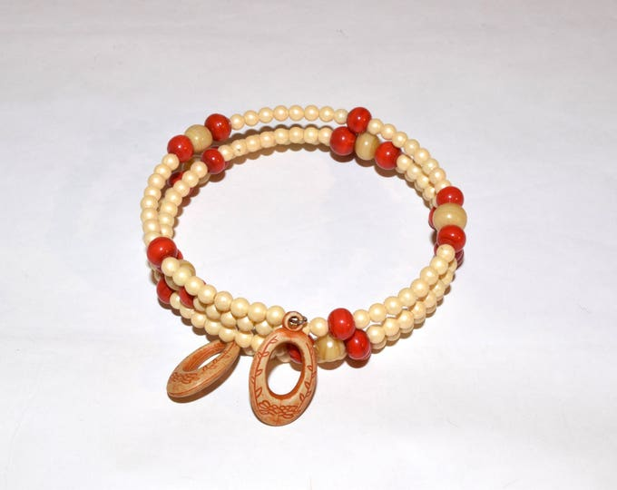 Red Orange, Cream and Off-White Beaded Wrap-Around Bangle with Charms- crafted by Nepalese human trafficking victims