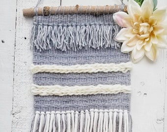 Hand woven wall hanging in gray and cream