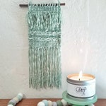 Handwoven wall hanging in mint green