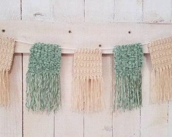 Hand woven banner in cream and sage