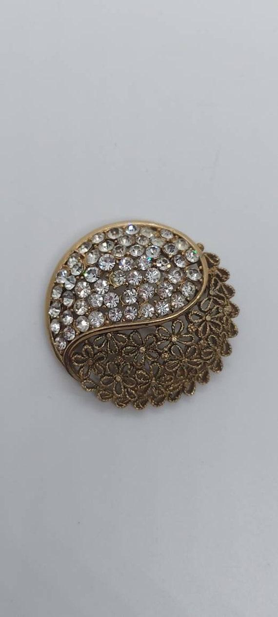 Karu Arke brooch antique gold and rhinestones