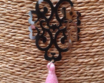 Silver necklace and pink tassel charm