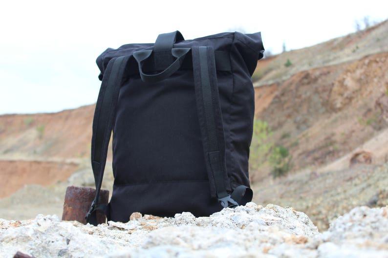 55ac2603d0b6 Roll top Black Cordura Backpack   Tatonka Buckles   YKK