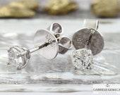 Brilliant stud earrings 5...