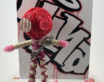 Handmade string doll with charm