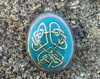 Celtic knotwork pocket stone from Irish sea
