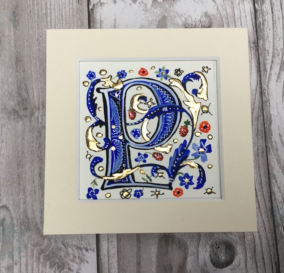 Illuminated Letter P, R, S or T, meval style initial letter, hand  on