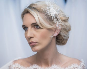 A delicate hair piece, with lace and crystals, with branches on both sides to make it easy to be attached to your hair.