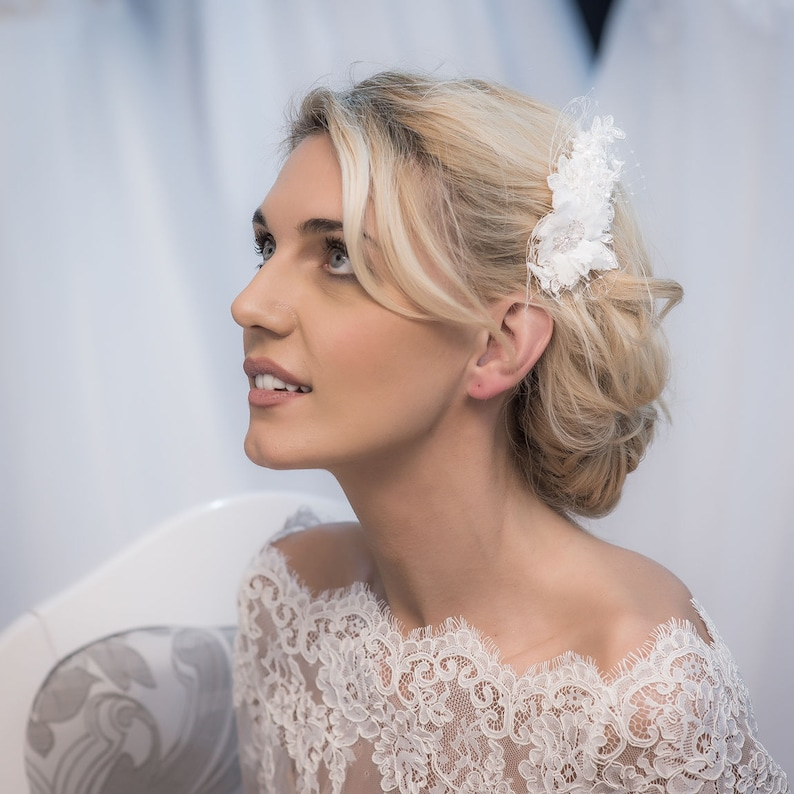 attached to a comb. A hair piece made of lace and crystals