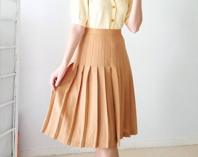 1980's 1980s vintage 1980's apricot pleated skirt