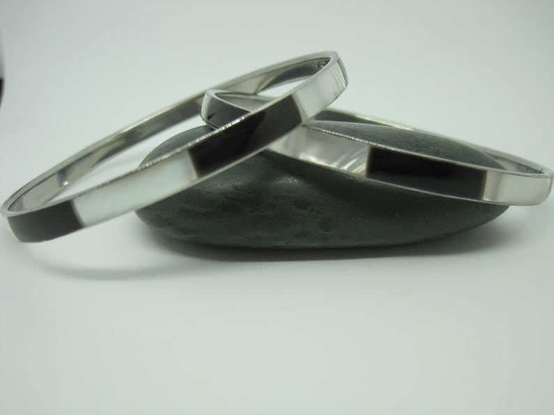 Two Alpaca Bangles In White and Black Mother of Pearl Inlaid Alpaca Bangle Bracelet.