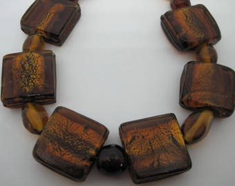 Beautiful, elegant, vintage, square dichroic amber colour glass beads necklace.