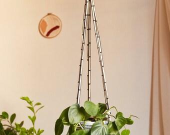White and black plant macramé suspension