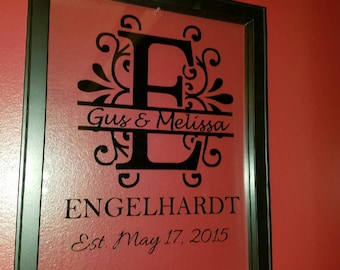 Monogrammed picture with both first names, last name and wedding date in 11x14 floating frame