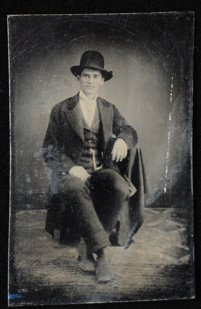 Dapper dude in casual pose in Victorian tintype photo