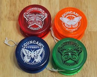 4 Vintage 1980'sDuncan yo-yos - Blue, Green, Red and Orange.