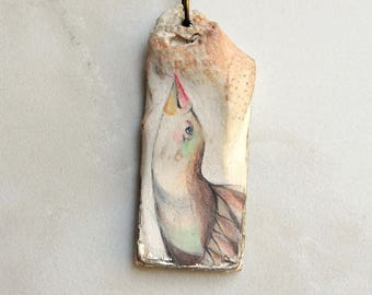 Pendant necklace with long neck birds posing gracefully painted in brown, ochre, pink, white and hints of aqua teal