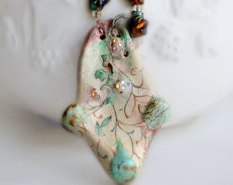 Painted cream pendant with vines and buds of turquoise