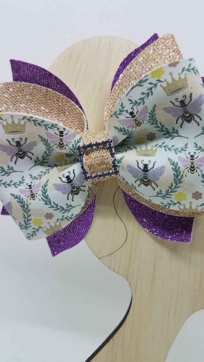 Crown queen bee purple gold glitter square belt gem centered phoebe hair bow