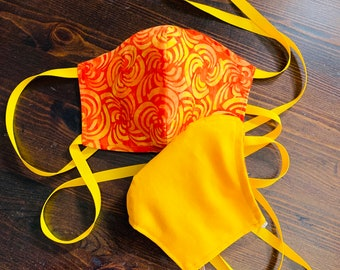PM2.5 filter included - Orange an Yellow Batik Mask with Filter Pocket- No Center Mask Seam