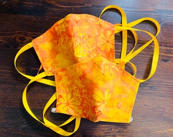 PM 2.5 filter included -Yellow and Orange Sunset Poppy Batik Mask with Filter Pocket - Made in the USA- No Center Mask Seam