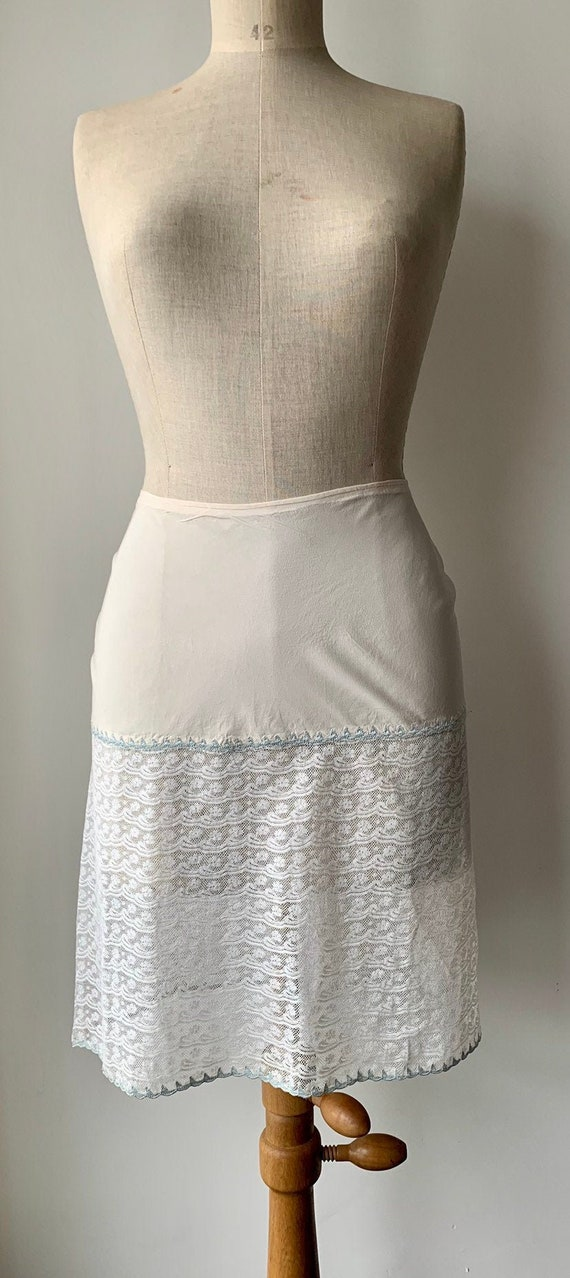 1920s silk and lace half slip with blue trimming,