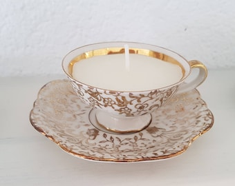 Small cup old scented candle