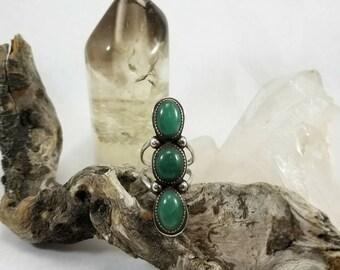 Amazonian emerald triple ring