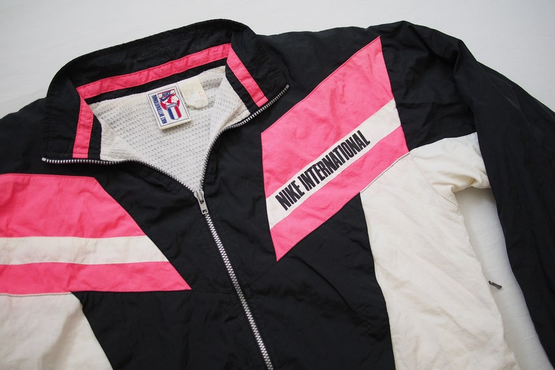 9e08857aa288 Vintage Retro NIKE International Pink Black White Vented