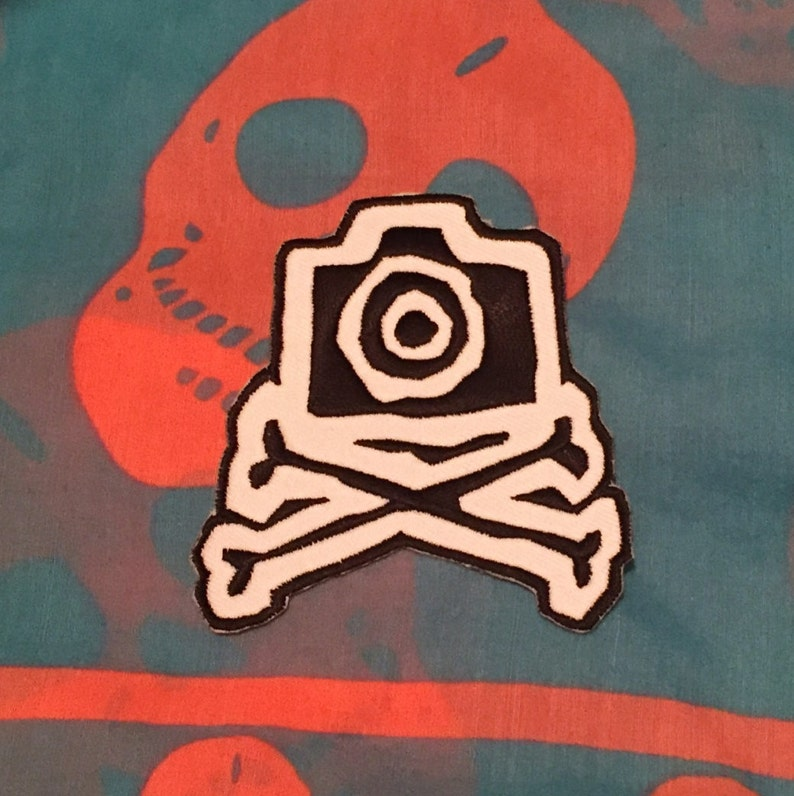 Camera and crossbones patch image 0