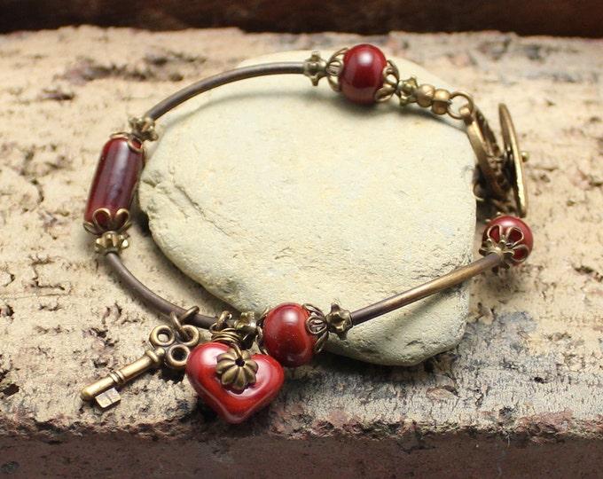 """Heart's Afire"" Lampwork Charm Bracelet"