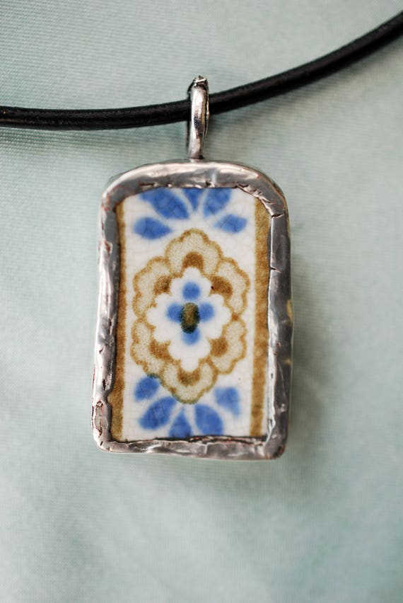 Herat Pendant is made from a broken plate shaped and hand soldered by me.