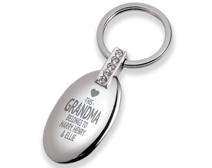 Engraved This GRANDMA belongs to keyring with 5 crystals, oval with a polished chromed finish  - 7128-BL3