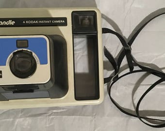 The Handle Kodak Instant Camera