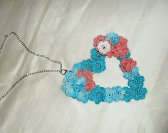 Crocheted heart necklace.