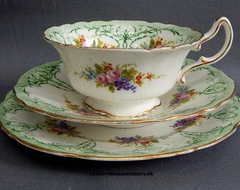 A Royal Doulton Cup, Saucer & Tea Plate Trio - Pattern 4046