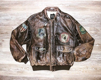 0f71674f210 Vintage Avirex A2 Flight Jacket • Bomber Jacket • Worn Leather with Patches  • 1987