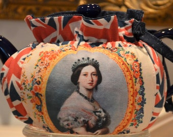 X SMALL TEA Cozy Drop In Snuggie Style fits a teapot that holds 12-16 Ozs is made with Queen Victoria and Albert and British Flag Cotton