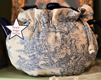 X SMALL Tea Cozy Drop In Snuggie French Blue on tan cotton toile fits a 12-16 Oz personal sized teapot is lined in blue cotton  pasley print