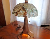 Beach Glass Lamp. This one of a kind Beach Glass Lamp is multi-coloured with a stunning copper base, hammered cap and finial.